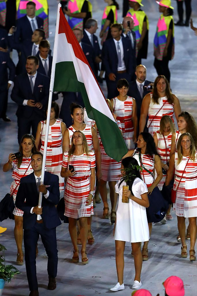 RIO DE JANEIRO, BRAZIL - AUGUST 05: Flag bearer Aron Szilagyi of Hungary leads his team during the Opening Ceremony of the Rio 2016 Olympic Games at Maracana Stadium on August 5, 2016 in Rio de Janeiro, Brazil. (Photo by Elsa/Getty Images)