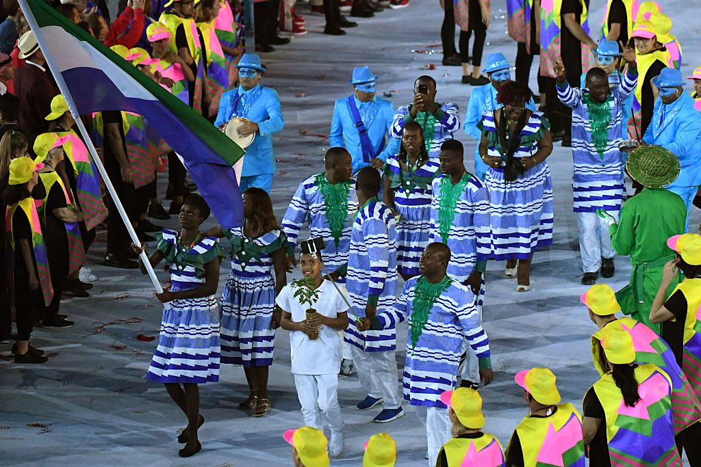 Sierra Leone's flagbearer Bunturabie Jalloh leads her delegation during the opening ceremony of the Rio 2016 Olympic Games at the Maracana stadium in Rio de Janeiro on August 5, 2016. / AFP / PEDRO UGARTE (Photo credit should read PEDRO UGARTE/AFP/Getty Images)
