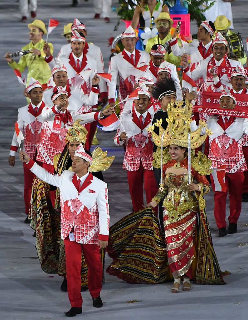 Members of Indonesia's delegation parade during the opening ceremony of the Rio 2016 Olympic Games at the Maracana stadium in Rio de Janeiro on August 5, 2016. / AFP / PEDRO UGARTE (Photo credit should read PEDRO UGARTE/AFP/Getty Images)
