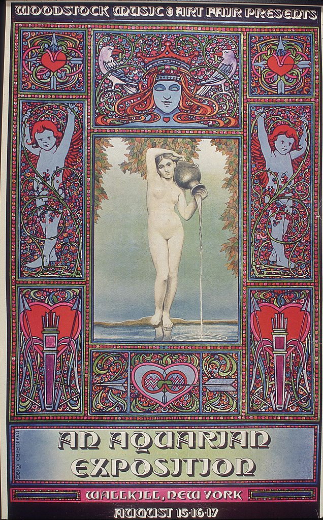 View of the original poster (David Byrd, artist) for the Woodstock Festival (or Woodstock Music and Art Fair, as the poster reads), 'An Aquarian Exposition,' 1969. The poster gives the event's original location of Wallkill, New York, which was changed shortly before the scheduled date, August 15-17, to Bethel, New York. (Photo by Blank Archives/Getty Images)