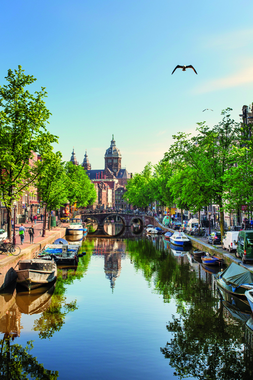 Netherlands, North Holland, Amsterdam. Oudezijds Achterburgwal Canal and Saint Nicholas Church (St Nicolaas Kerk)