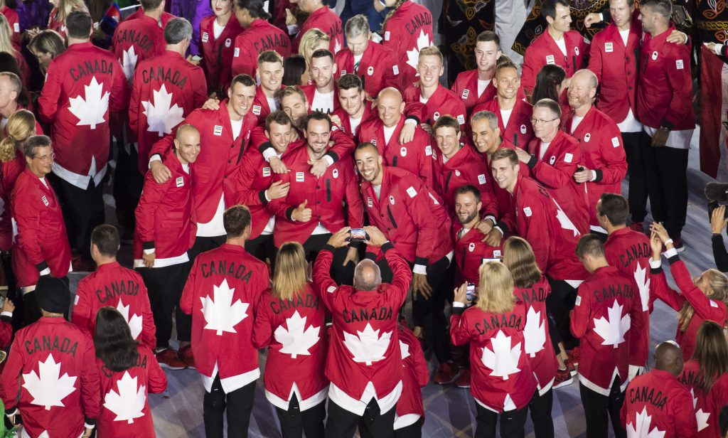 Team Canada takes pictures as they arrive during the opening ceremony for the Olympic games at Maracana Stadium in Rio de Janeiro, Brazil, Friday August 5, 2016. COC Photo/Mark Blinch