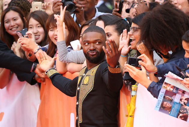 """TORONTO, ON - SEPTEMBER 10: David Oyelowo greets fans at the 2016 Toronto International Film Festival - """"Queen Of Katwe"""" premiere held at Roy Thomson Hall on September 10, 2016 in Toronto, Canada. (Photo by Michael Tran/WireImage)"""
