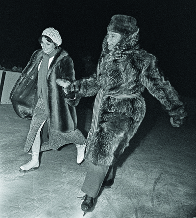 Prime Minister Pierre Trudeau accompanies Miss Margaret Sinclair, at the annual Governor General's skating party for members of Parliament in Ottawa Jan. 14, 1970. (CP PHOTO/Peter Bregg)
