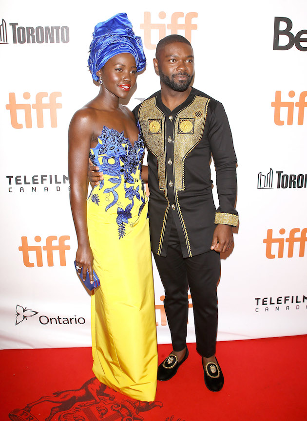 """TORONTO, ON - SEPTEMBER 10: Lupita Nyong'o (L) and David Oyelowo arrive at the 2016 Toronto International Film Festival - """"Queen Of Katwe"""" premiere held at Roy Thomson Hall on September 10, 2016 in Toronto, Canada. (Photo by Michael Tran/WireImage)"""