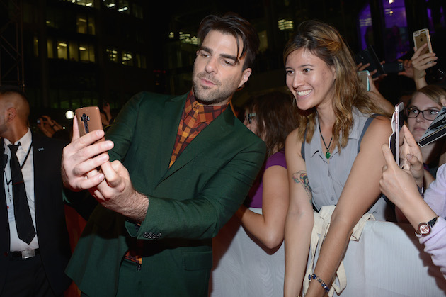"""TORONTO, ON - SEPTEMBER 09: Actor Zachary Quinto takes a selfie with fans at the """"Snowden"""" premiere during the 2016 Toronto International Film Festival at Roy Thomson Hall on September 9, 2016 in Toronto, Canada. (Photo by GP Images/WireImage)"""