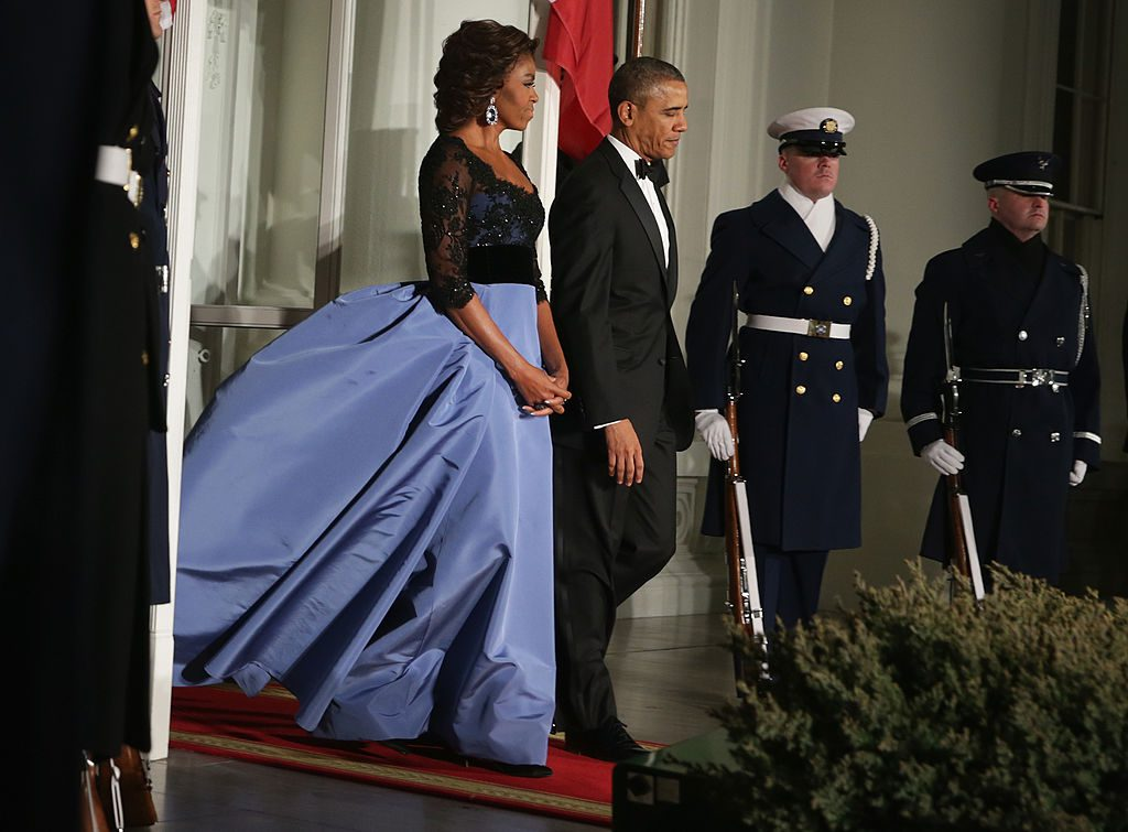 WASHINGTON, DC - FEBRUARY 11: U.S. President Barack Obama (R) and first lady Michelle Obama (L) come out to the North Portico to wait for the arrival of French President François Hollande for a state dinner at the White Houes February 11, 2014 in Washington, DC. President Hollande is on a three-day state visit to the U.S. (Photo by Alex Wong/Getty Images)