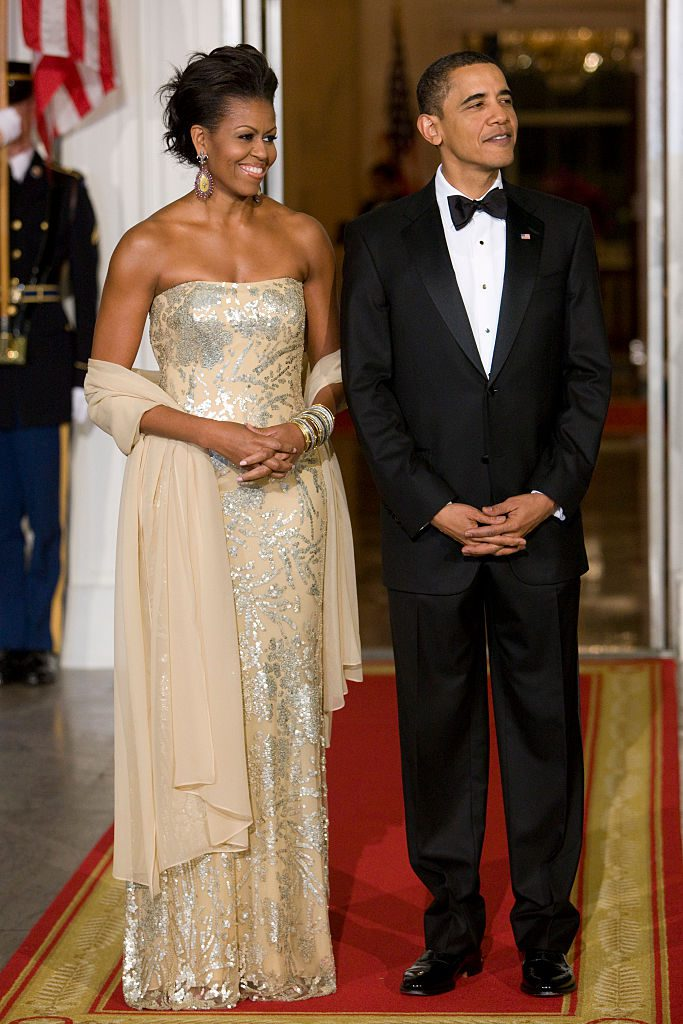 """""""U.S. President Barack Obama and first lady Michelle Obama await the arrival of India's Prime Minister Manmohan Singh and his wife Gursharan Kaur for a state dinner on the North Portico of the White House. """" (Photo by Brooks Kraft LLC/Corbis via Getty Images)"""