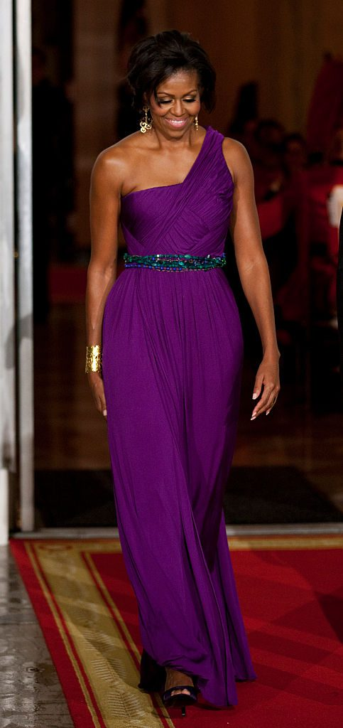 First lady Michelle Obama arrives with President Barack Obama to greet South Korean President Lee Myung-bak and his wife Kim Yoon-ok on the North Portico of the White House in Washington for a state dinner. (Photo by Brooks Kraft LLC/Corbis via Getty Images)