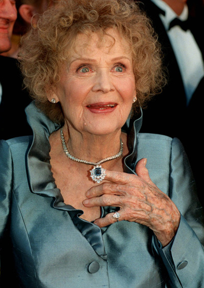Lady in blue: Gloria Stuart arrives at the 70th Annual Academy Awards wearing one of the world's biggest blue diamonds -- a tribute, courtesy of jeweler Harry Winston, to the signature gem her character tossed into the sea in Titanic.