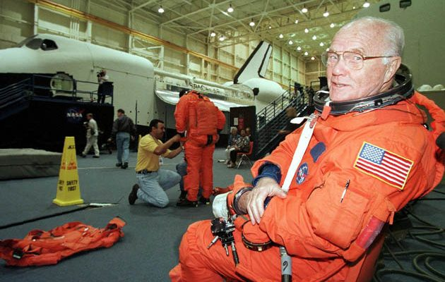 HOUSTON, :  Astronaut and US Senator John Glenn (D-Ohio), waits for assistance from NASA personnel during a space shuttle training session at the Lyndon B. Johnson Space Center in Houston, TX, 01 June. Senator Glenn, the first US astronaut to orbit the Earth on his Mercury mission in 1962, will be a payload specialist on the shuttle crew STS-95 that is scheduled for launch in October. He will be the oldest person ever to fly in space.  AFP PHOTO/PAUL K. BUCK (Photo credit should read PAUL BUCK/AFP/Getty Images)