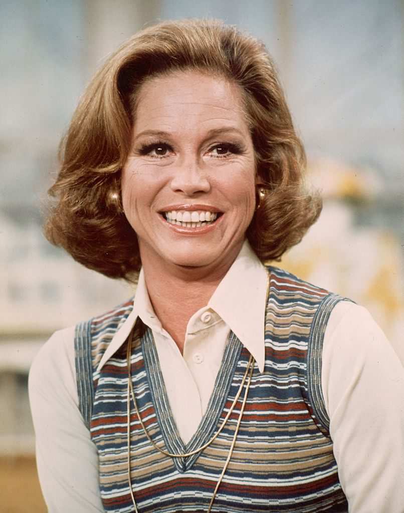 circa 1977: American actor Mary Tyler Moore smiling in a headshot still from the television series, 'The Mary Tyler Moore Show'. She is wearing a white blouse with a striped knit vest. (Photo by CBS Photo Archive/Getty Images)