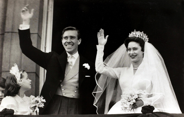 British Royalty, London, England, 6th May 1960, H,R,H, Princess Margaret with her Anthony Armstrong-Jones wave to the crowd from the balcony of Buckingham Palace after they had been married in Westminster Abbey (Photo by Bob Thomas/Popperfoto/Getty Images)