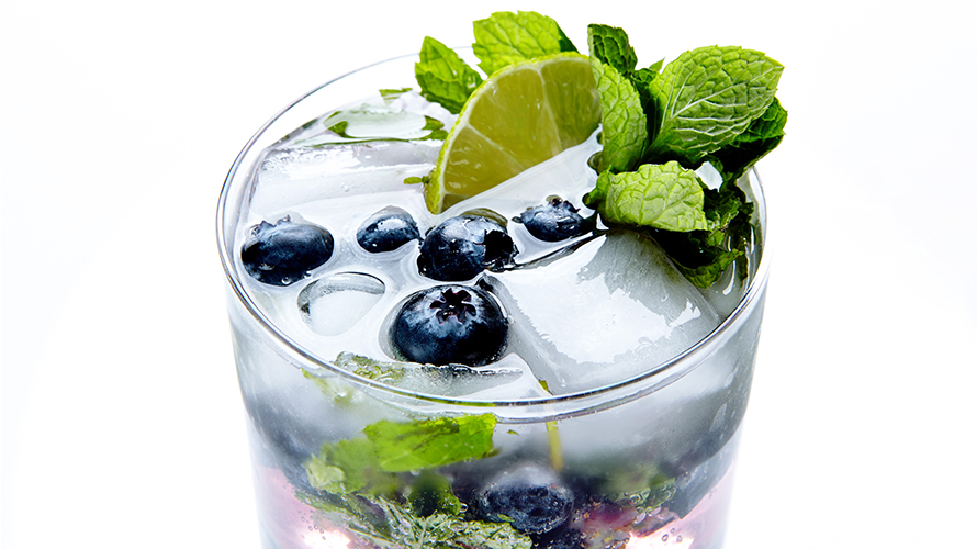 A blueberry mojito with fresh mint, sweet blueberries and lime.
