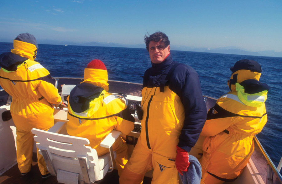 Allan Thorton and his team clad in yellow windbreakers on a boat off the coast of Japan.