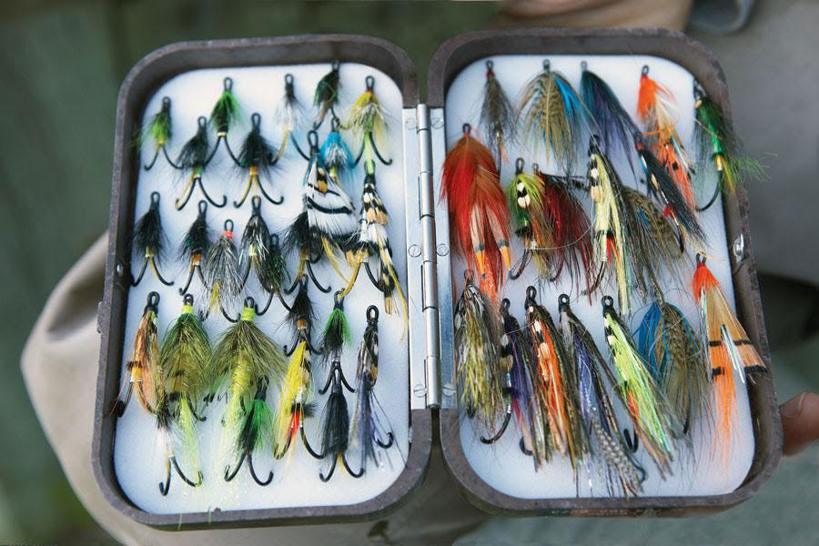 A box of multicoloured salmon flies.