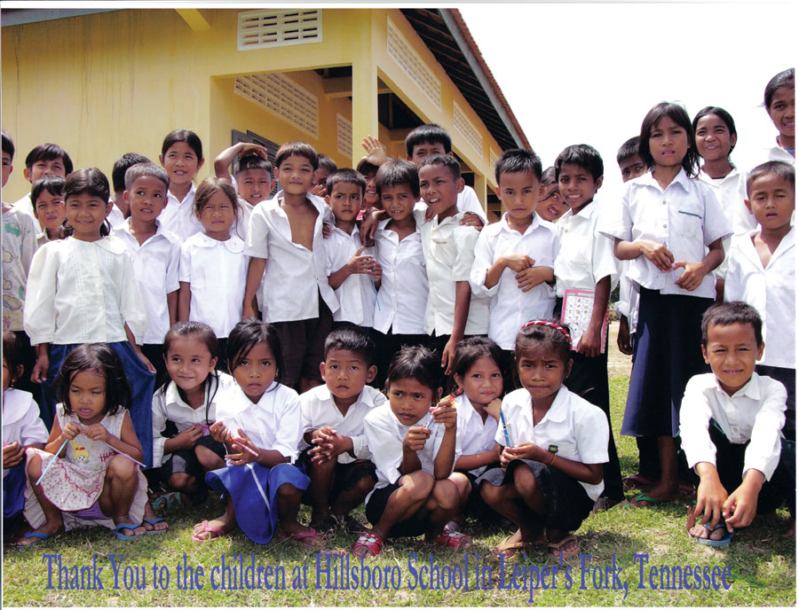 A thank-you card from the students in Cambodia to the kids in Tennessee who helped raise funds. The card features several of the students wearing white dress shirts. Thank you to the children at Hillsboro School in Leiper's Fork, Tennessee is written across the bottom.