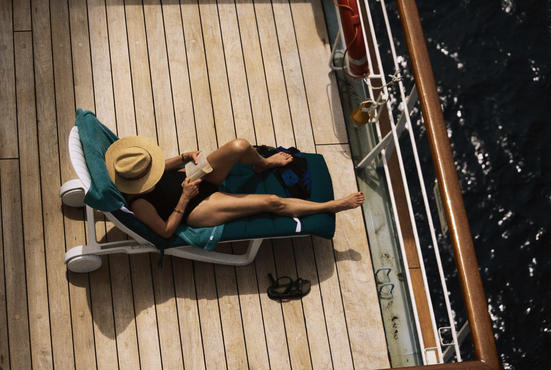 Woman reading a book on a cruise.