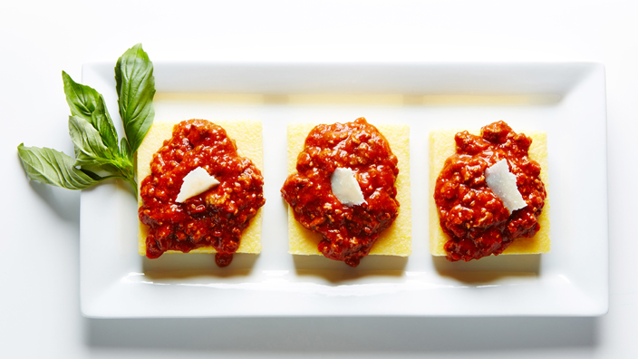 Parmesan Polenta topped with homemade rich and robust Bolognese sauce.