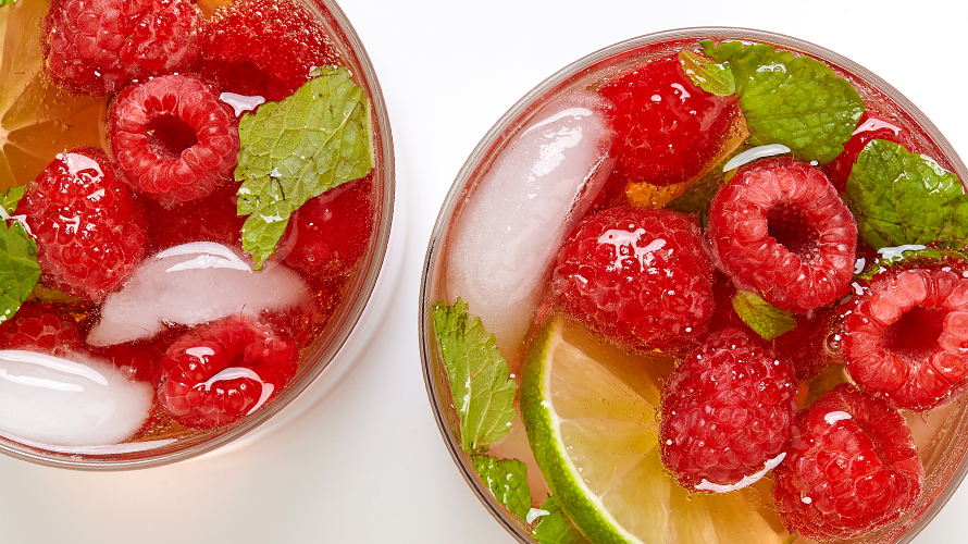 A Raspberry Rosé featuring fresh mint leaves, raspberries, rosé wine and rum.