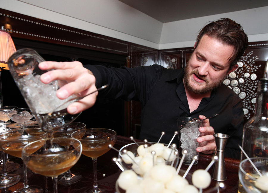"""Celebrity bartender Russell Davis of Spike TV pours """"The Valet"""" into martini glasses."""