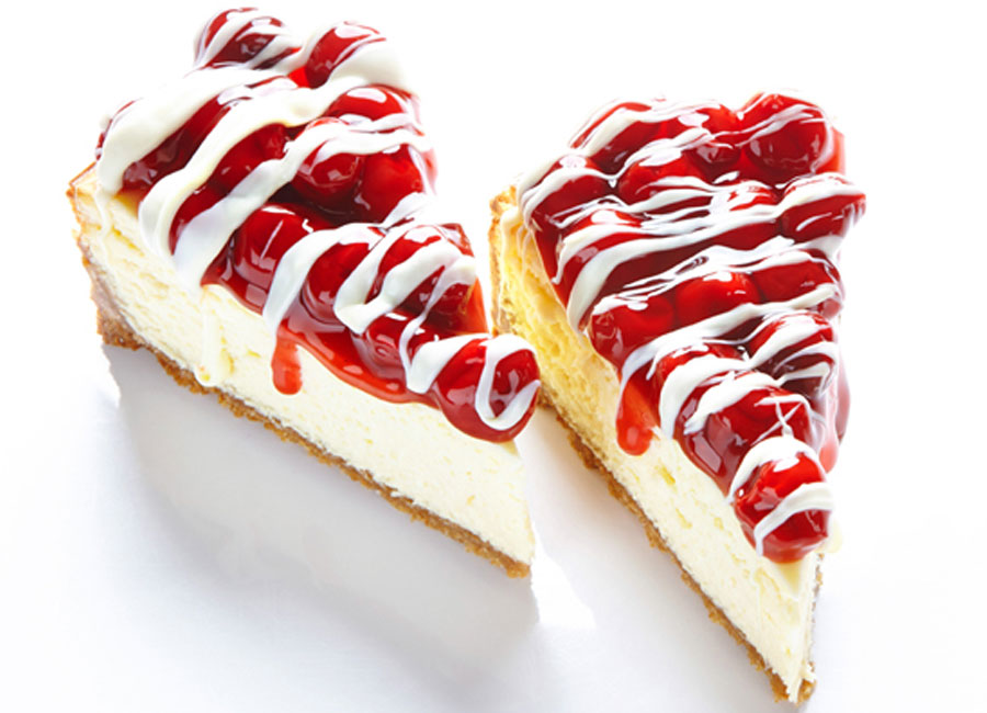 A buttery graham cracker crust is topped with smooth white chocolate cheesecake and topped with sweet cherries.