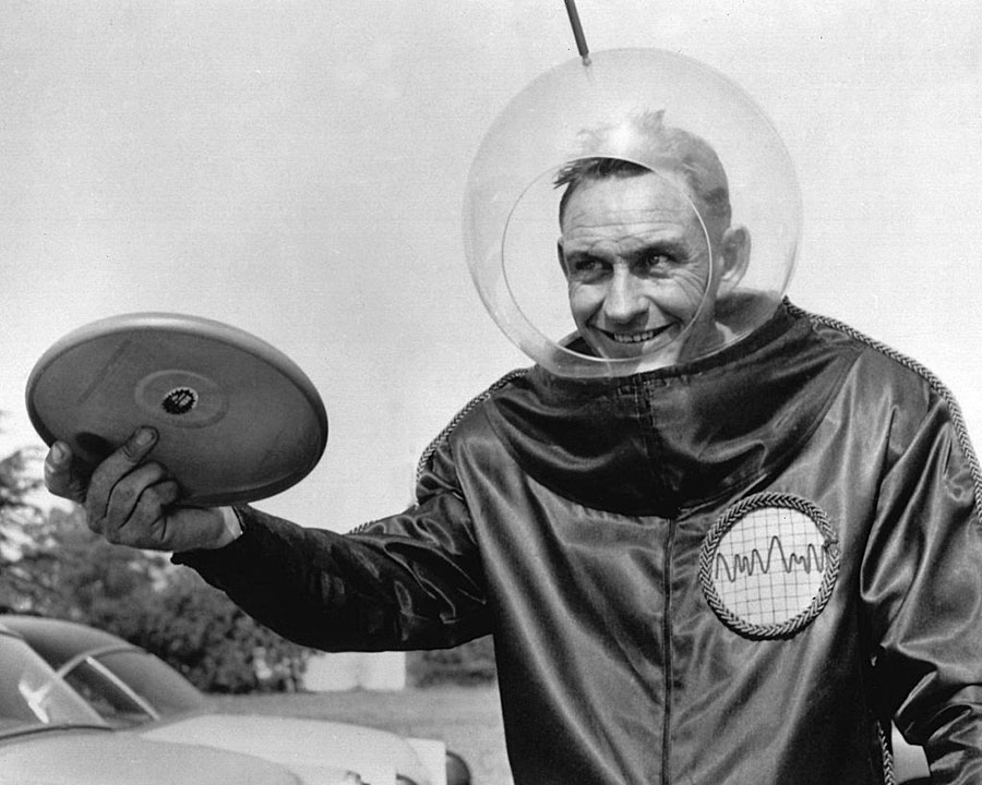 Walter Fredrick Morrison in a spacesuit holding the Pluto Platter, which was the forerunner to the fisbee.