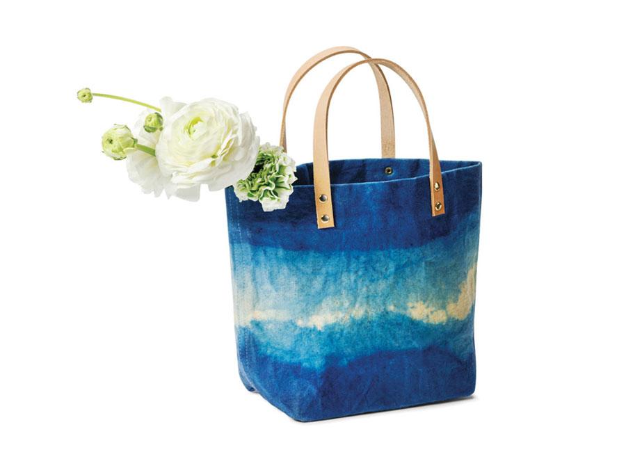 Ombre blue canvas shopper holding flowers
