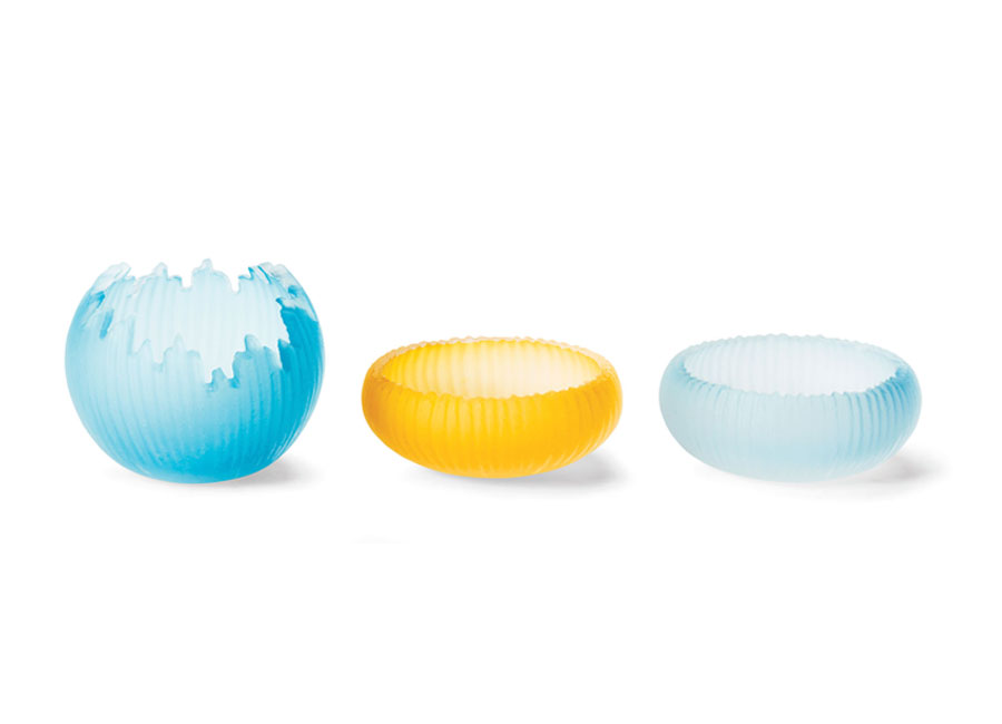 Three decorative glass bowls in pale blue and bright yellow