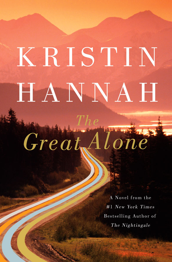 The book cover for The Great Alone featuring a winding road with forest on each side.