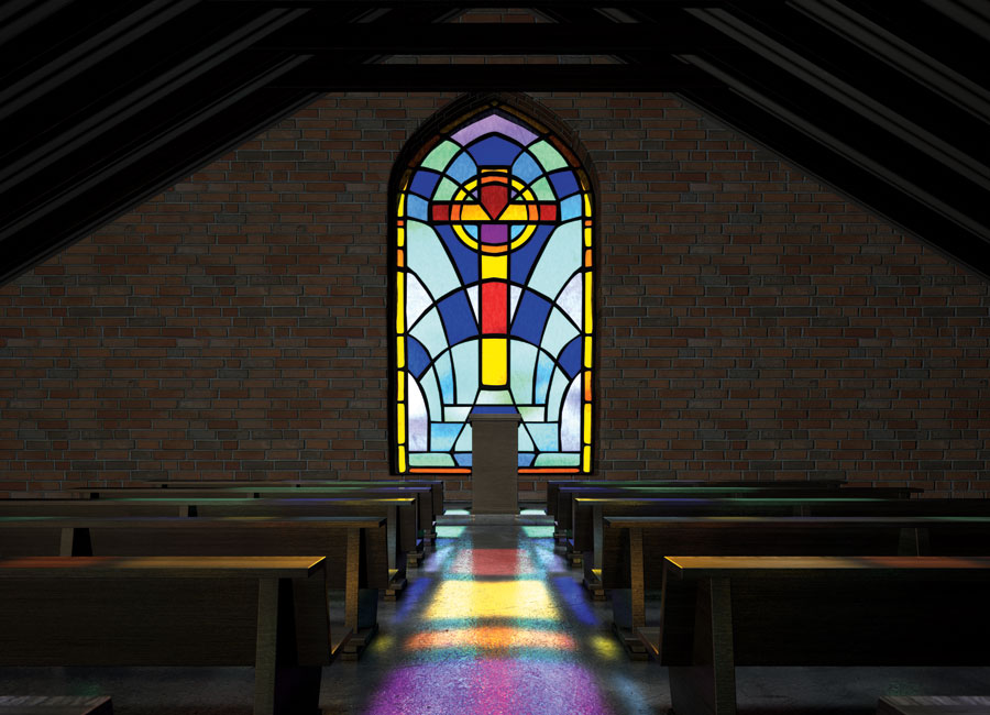 The centre aisle in between two rows of pews leading to a stain glass window with a colourful cross.