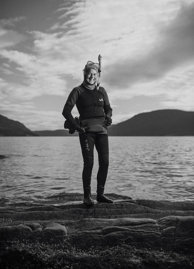 Jane Armstrong standing on the rocky shore of Salt Spring in British Columbia.
