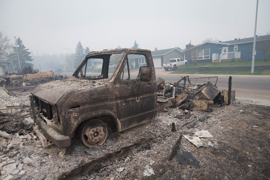 A scorched pickup truck on a residential street in Alberta Fort McMurray after the fires.