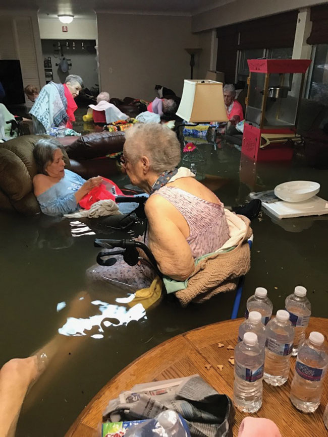 Nursing home residents wait to be rescued in waist high flood waters.
