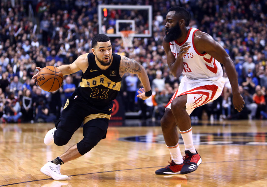 Fred VanVleet of the Toronto Raptors dribbles the ball as James Harden of the Houston Rockets defends.