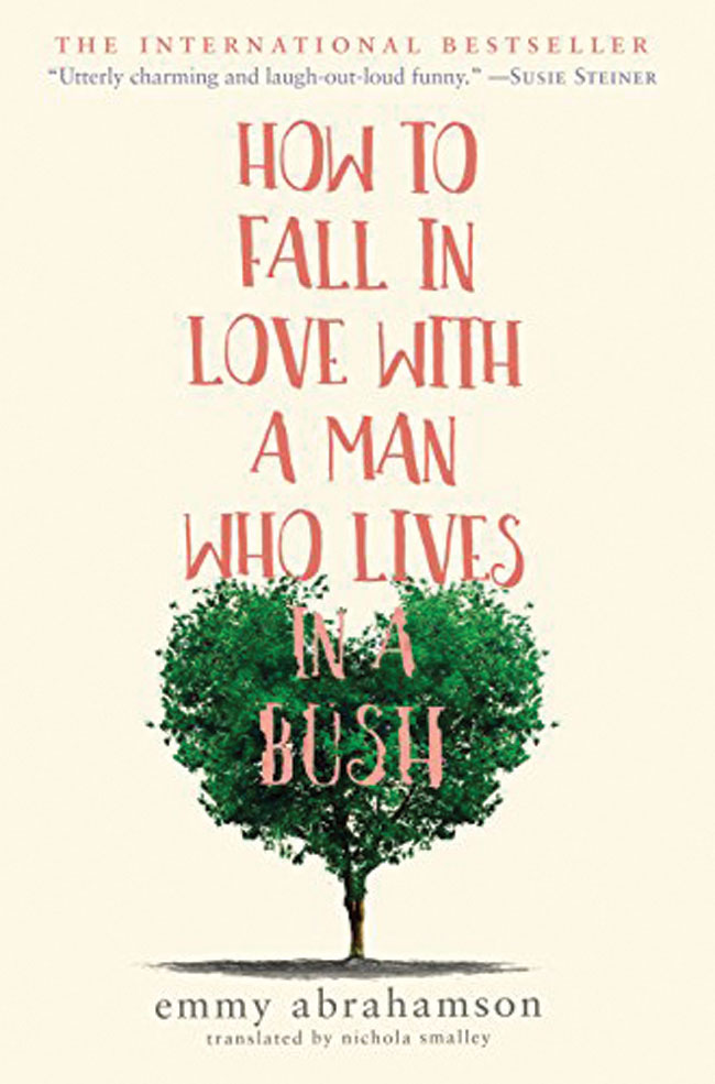 The book cover for How To Fall In Love With a Man Who Lives In a Bush. The title in red capital letters overtop of a small bush.