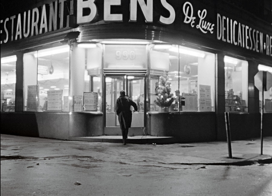 A black and white photo of Leonard Cohen entering the legendary Bens De Luxe Deli in the 1965 NFB documentary Ladies and Gentlemen...Mr. Leanard Cohen.