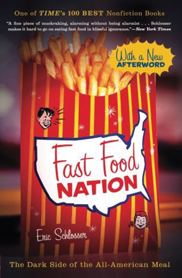 The book cover for fast food nation. The title is written on the front of a carton of fries.