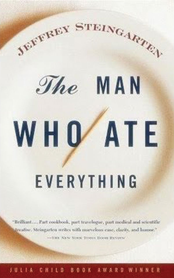 The book cover for The Man Who Ate Everything. The title is displayed on an empty plate save for a toothpick.