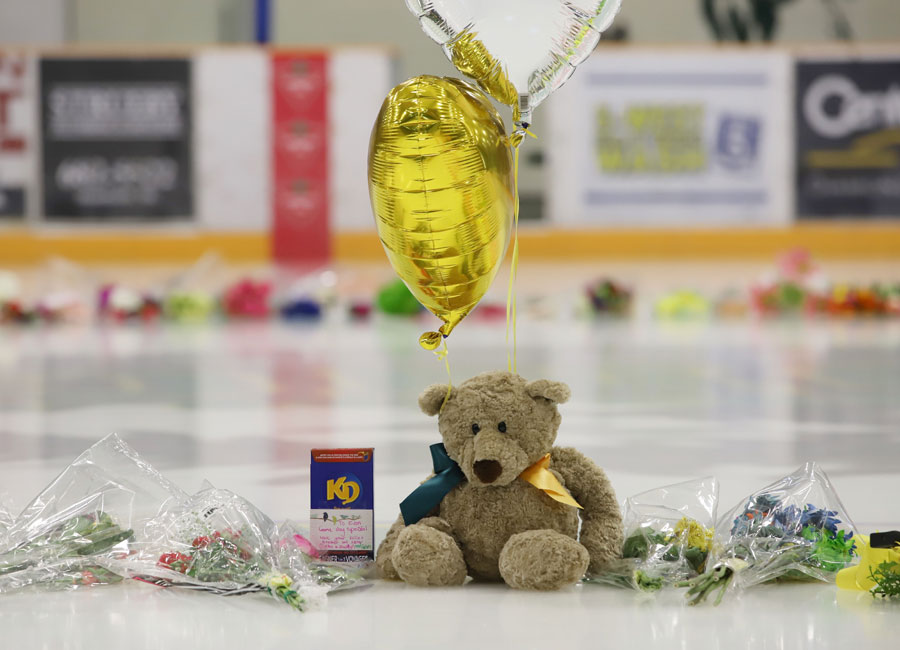 Flowers, cards and sentimental gifts adorn the ice surface at Humboldt Uniplex during preparations for a prayer vigil for the Humboldt Broncos ice hockey team, April 8, 2018 in Humboldt, Canada. Mourners in the tiny Canadian town of Humboldt, still struggling to make sense of a devastating tragedy, prepared Sunday for a prayer vigil to honor the victims of the truck-bus crash that killed 15 of their own and shook North American ice hockey. / AFP PHOTO / Kymber RAE (Photo credit should read KYMBER RAE/AFP/Getty Images)
