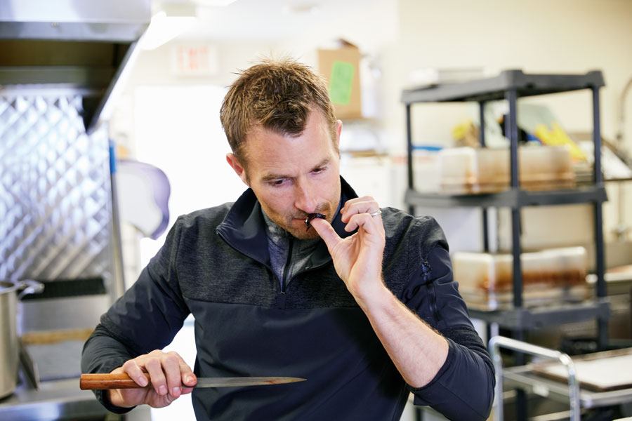 Chef Ned Bell trying seal for the first time.