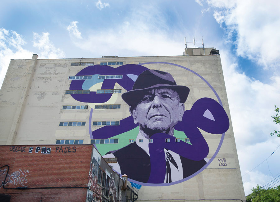 A nine-storey mural of Leonard Cohen on the side of a building in Montreal.