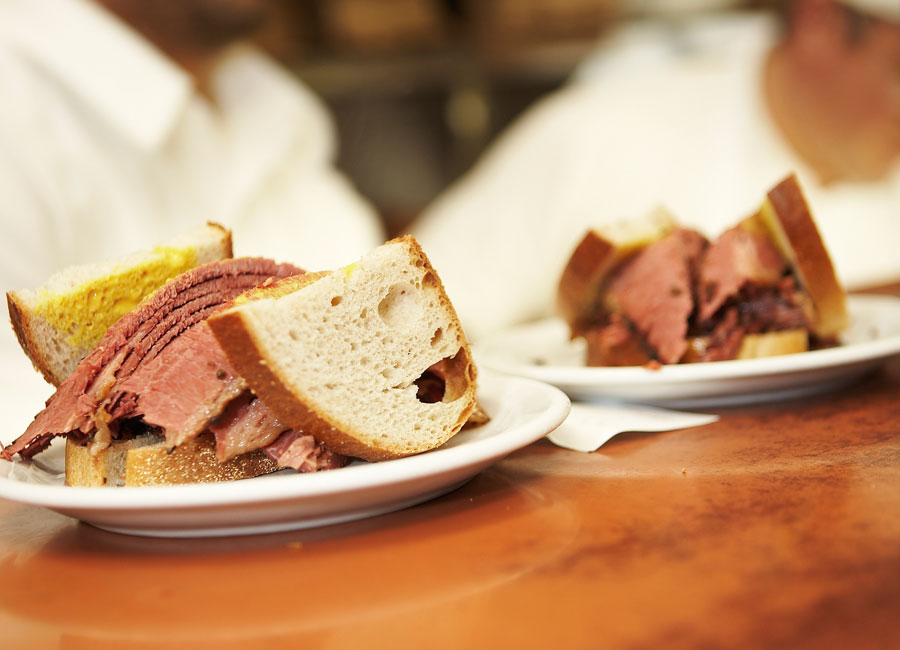 Two Montreal smoked meat sandwiches.