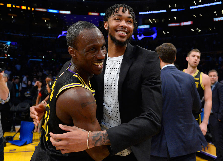 Andre Ingram hugs a fellow player after his NBA debut.
