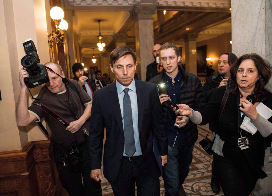 Patrick Brown surrounded by reporters amidst scandal.