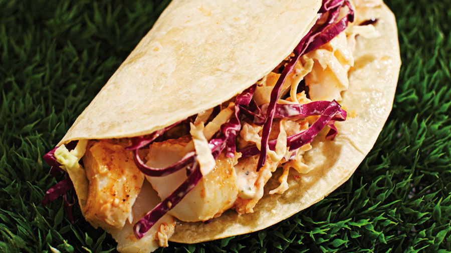 Tender cod marinated in spice and zesty lime, baked to juicy perfection and folded in a tender tortilla with a spicy chipotle lime dressing and crunchy cabbage.