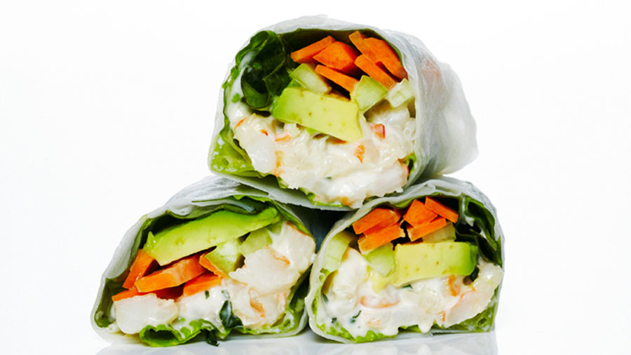 Shrimp Rice Paper Rolls filled with a zesty shrimp salad, creamy avocado and crunchy vegetables.