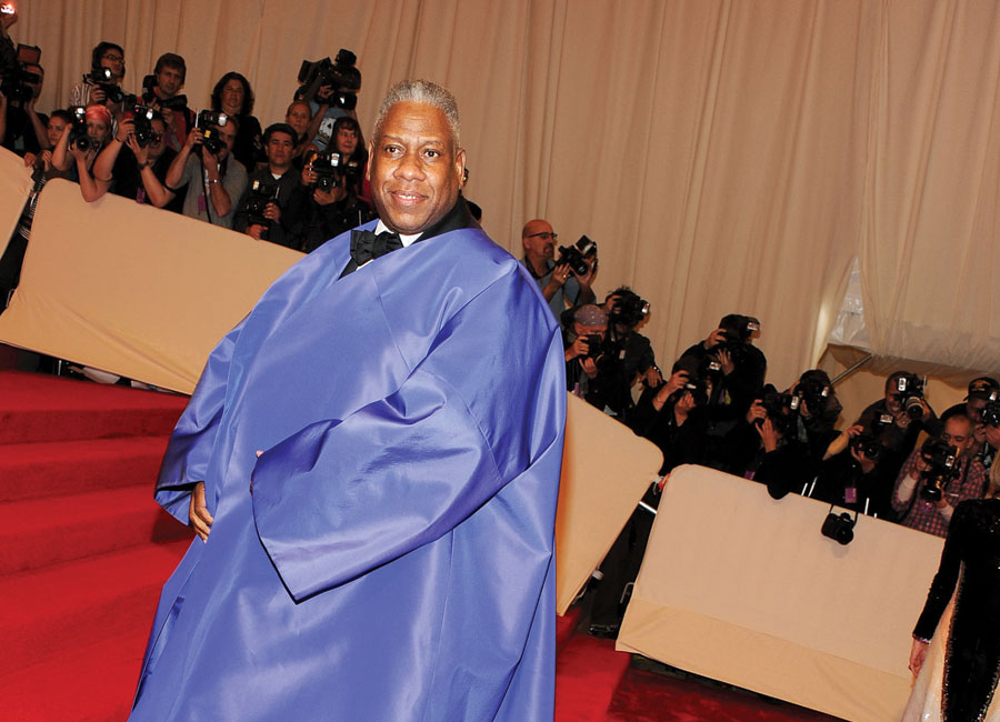 André Leon Talley in a purple gown-like poncho.