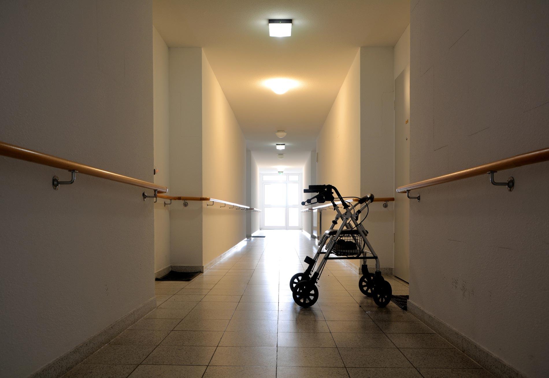 Walker in a hallway in nursing home.
