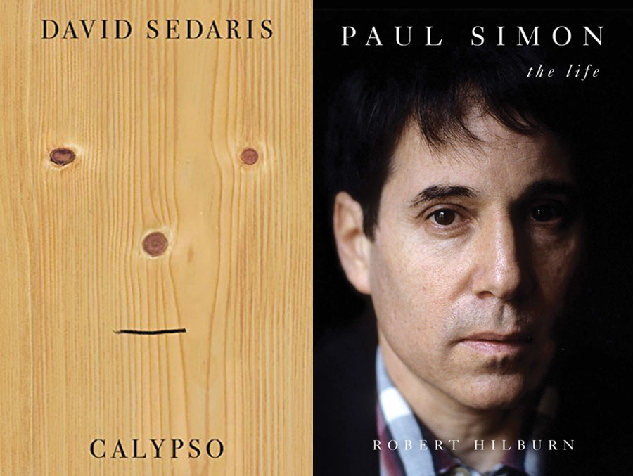 The cover for Paul Simon: The Life with a photo of a young Paul Simon and a second book cover for Calypso which features a photo of a piece of wood with scores in the formation of eyes, nose and a mouth added in black marker.